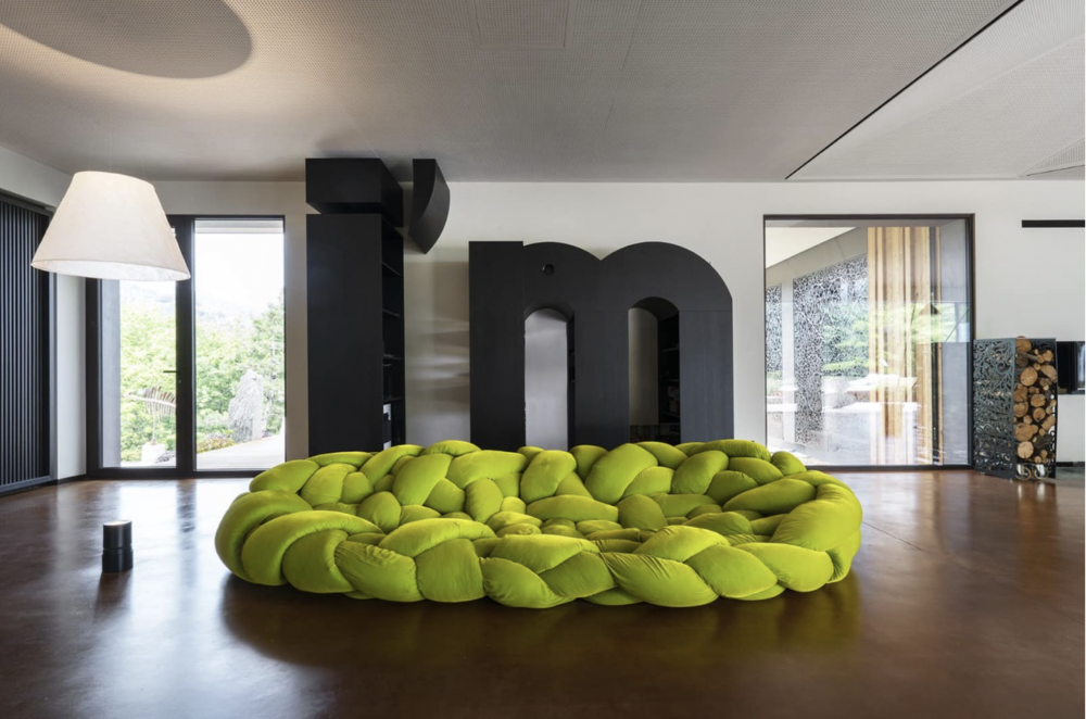 BOA by FERNANDO E HUMBERTO CAMPANA. Boa is a large woven nest. An enveloping hug. An invitation to explore different positions by lying down between its cushions.